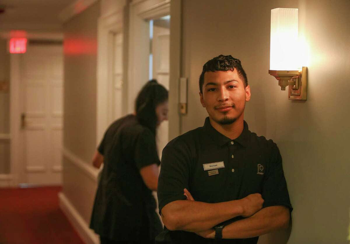 The Lancaster Hotel raised its minimum wage to $12 an hour for all employees, which is very high for Texas standards. Michael Martinez, a 23-year-old who does all kinds of jobs at the hotel, from attending the buffet to cleaning rooms poses for a photograph Tuesday, June 7, 2016, in Houston.