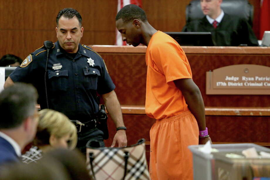 Darrell P. Mitchell, 27, charged with capital murder in the death of ex-girlfriend and her boyfriend, makes a first appearance charged with capital punishment in front of Judge Ryan Patrick in the 177th District Criminal Court at the Harris County Courthouse, Thursday, June 9, 2016, in Houston, Texas. Photo: Gary Coronado, Houston Chronicle / © 2015 Houston Chronicle