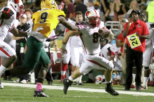 Kade Harrington, 8, runs through the Lion defense during the game between the Lamar Cardinals and the Southeastern Louisiana University Lions at Strawberry Stadium in Hammond, LA, Thursday, October 1st, 2015 - photo provided by Kyle Ezell