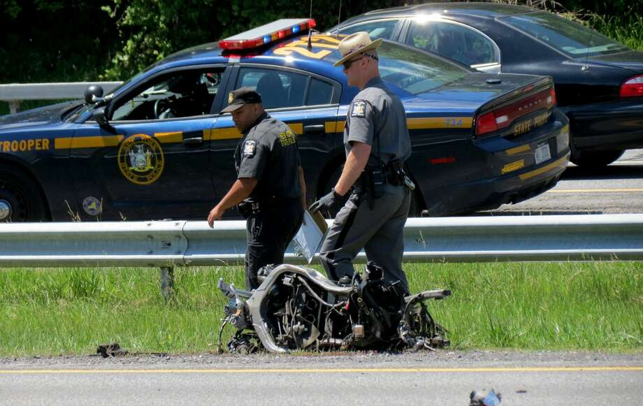 Police investigate a motorcycle crash on I87 between Albany and Bethlehem on Thursday, June 9, 2016. (Thomas Heffernan Sr./Special to the Times Union) Photo: Picasa