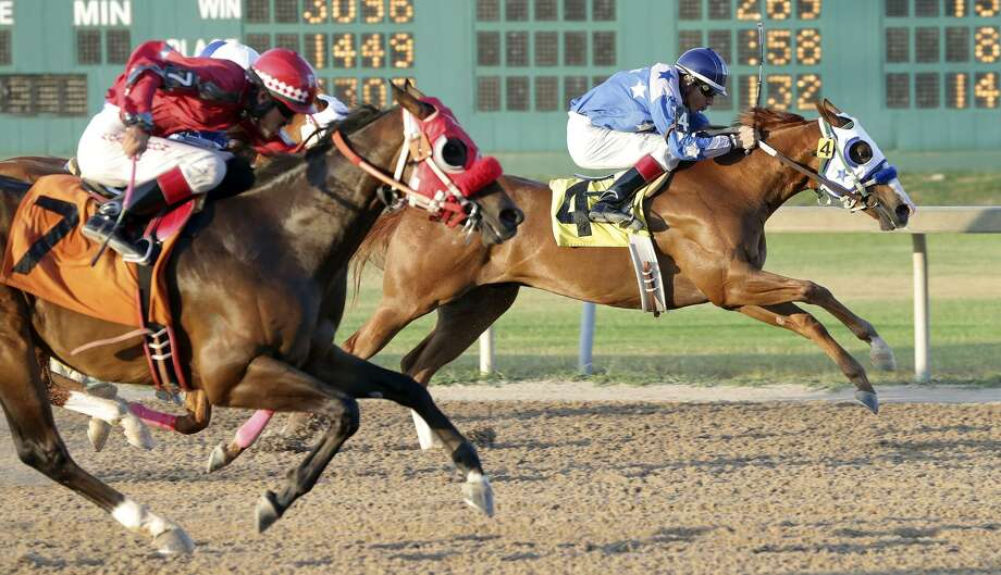 A Miami federal judge this week barred Christopher J. Hall, the former chairman of a company that at one time operated Retama Park horse track in Selma, from serving as an officer or director of a public company for 10 years. In February, a jury determined Hall had violated securities laws. Pictured is a 2015 race at the track. Photo: Tom Reel /San Antonio Express-News / San Antonio Express-News