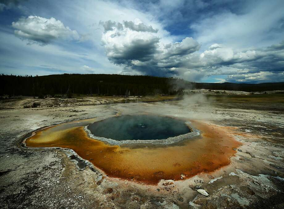 The Crested Pool hot spring, in Yellowstone National Park in Wyoming, gets its distinctive colors from bacteria that survive in the hot water. Photo: MARK RALSTON, AFP/Getty Images
