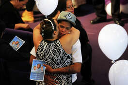 Mourners embrace before the funeral service for Jesenia Valentin, 28, her 9-year daughter, Angelina Rodriguez, and her 14-year old niece, Asyria Ferrer at Cathedral of Praise Church of God in Christ International, in Bridgeport, Conn. June 9, 2016. The three were killed on June 1, 2016 in an accident on Interstate 84 in Orange County, New York. Valentin's car had run out of gas in a right lane of the interstate and was stuck from behind by a tractor-trailer.