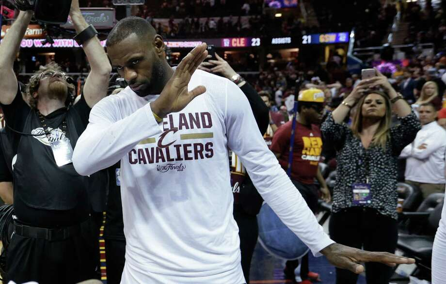 Cleveland Cavaliers' LeBron James celebrates the team's 120-90 win over the Golden State Warriors in Game 3 of basketball's NBA Finals in Cleveland, Wednesday, June 8, 2016. (AP Photo/Tony Dejak) ORG XMIT: OHPS144 Photo: Tony Dejak / Copyright 2016 The Associated Press. All rights reserved. This m