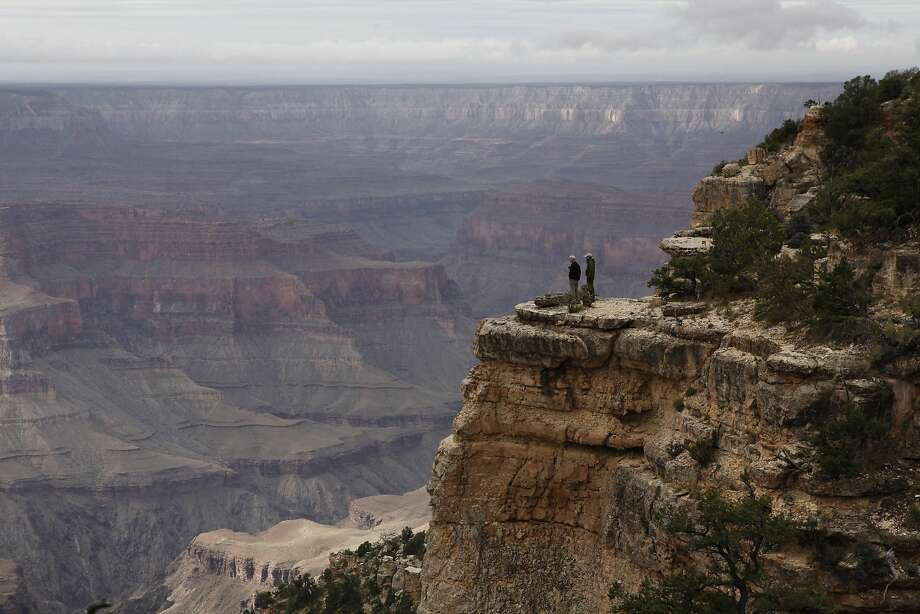 Visitors look over the Grand Canyon from Powell Plateau. Photo: Chris Walker, MCT