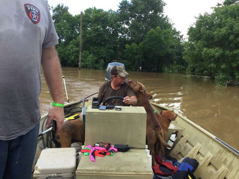 The Hamilton family is among the volunteers helping rescue animals from flood waters in Brazoria County so they can be treated by the SPCA. Photo: Hamilton Family