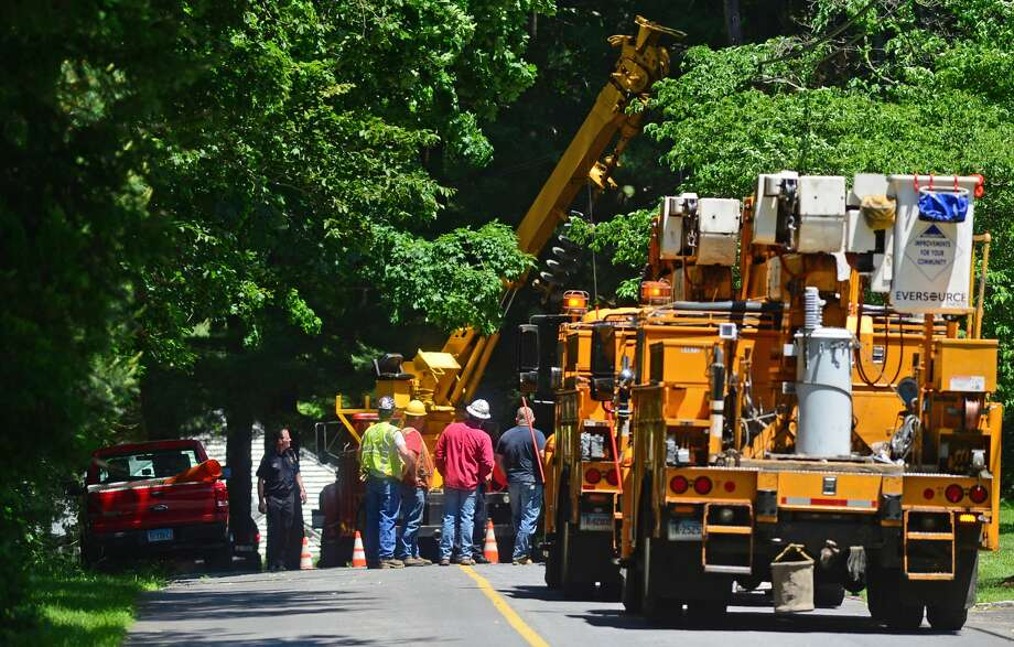 Eversource employees and Wilton police investigate a work related accident on Blue Ridge Lane in Wilton, Conn. Thursday June 9, 2016. Photo: Erik Trautmann
