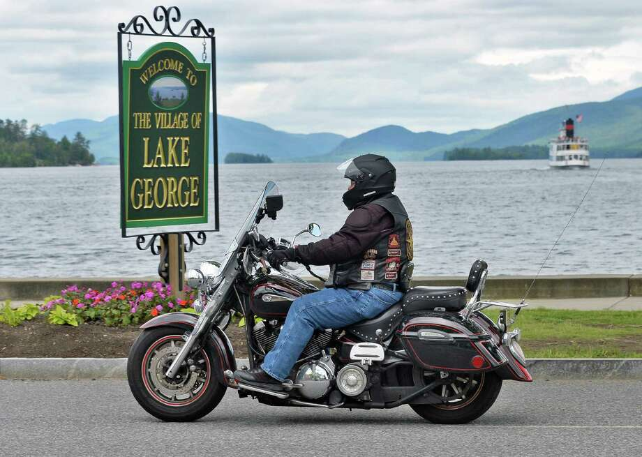 A motorcyclist rides along Lake George during Americade Thursday June 9, 2016 in Lake George Village, NY.  (John Carl D'Annibale / Times Union) Photo: John Carl D'Annibale / 20036704A