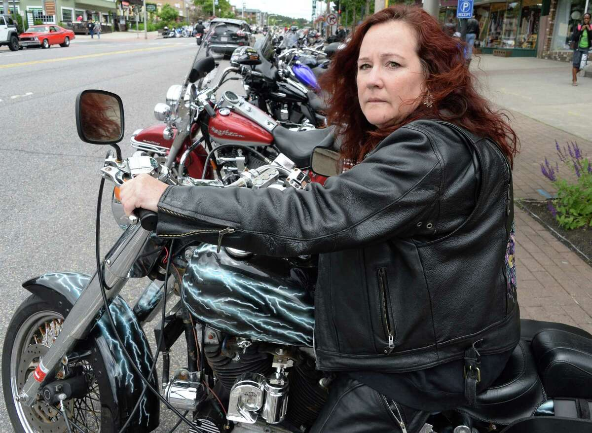 Click through the slideshow to view photos from Americade 2016, held in June in Lake George . Mary Rose of Albany parks her Harley Davidson Sportster on Canada Street during Americade Thursday June 9, 2016 in Lake George Village, NY. (John Carl D'Annibale / Times Union)