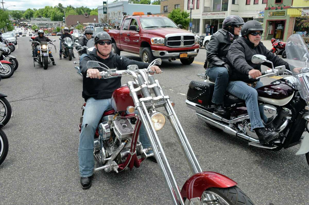 Joe Herringshaw, center, of Ilion, Herkimer County, rides his Bourget Dragon chopper up Canada Street during Americade Thursday June 9, 2016 in Lake George Village, NY. (John Carl D'Annibale / Times Union)