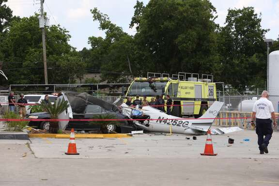 A deadly plane crash is pictured at 6860 Telephone Road on Thursday, June 9, 2016.