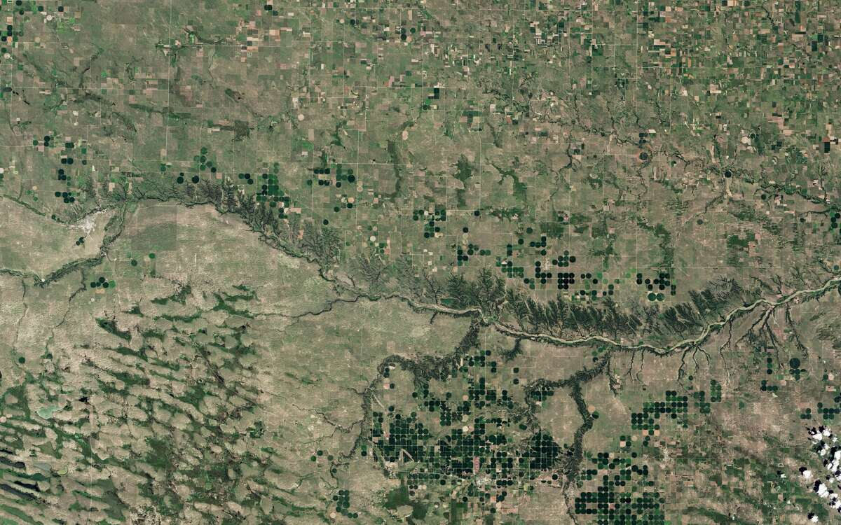 On July 16, 2015, Landsat 8 captured these natural-color images of the Niobrara. The river, stretching more than 800 kilometers (500 miles), is a tributary of the Missouri River. The 122-kilometer (76-mile) segment pictured here, which begins near the town of Valentine and flows east, was declared a National Scenic River in 1991.