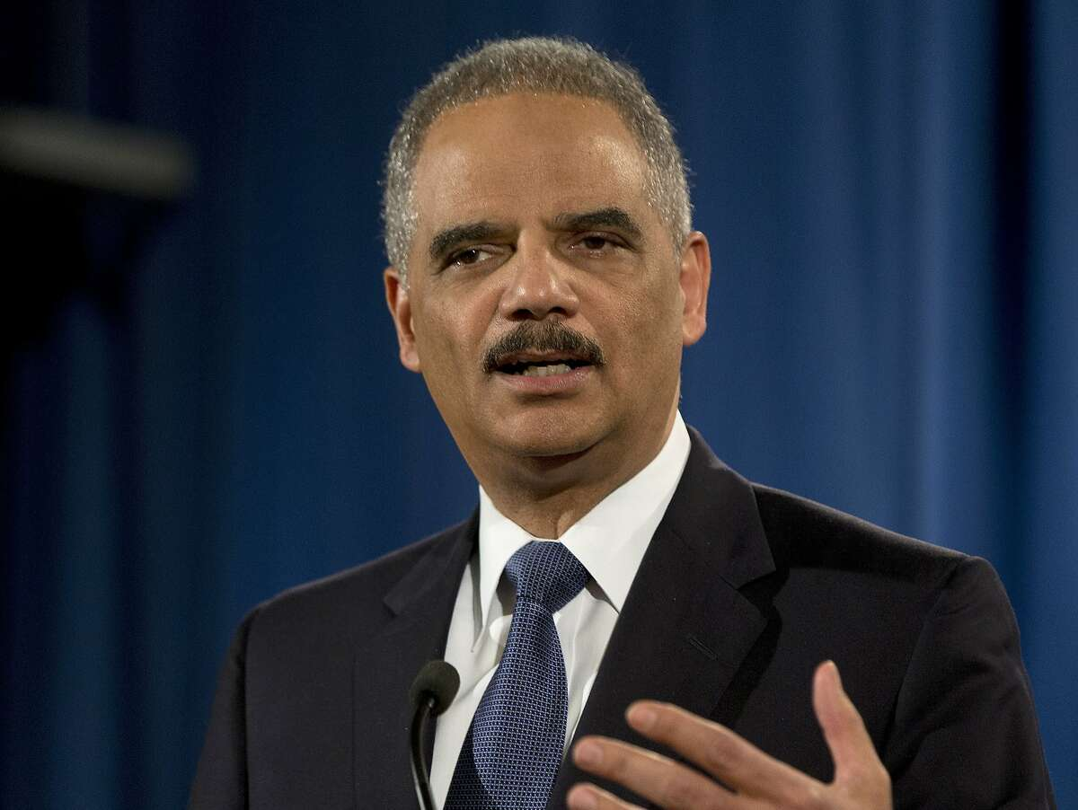 FILE - In this March 4, 2015, file photo, then-Attorney General Eric Holder speaks at the Justice Department in Washington. Holder says Edward Snowden performed a
