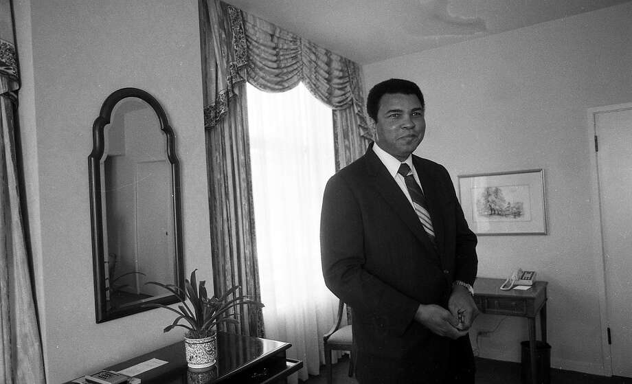 May 1, 1988: Muhammad Ali at the Clift Hotel in San Francisco, hours after he had been declared missing by police and created a stir. He met with San Francisco Chronicle journalists in his hotel room. Photo: Deanne Fitzmaurice, The Chronicle