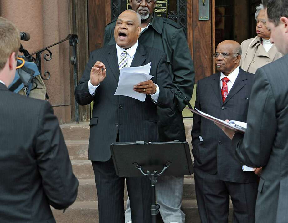 "Pastor David Traynham of New Horizons Christian Church speaks as NAACP, African American Clergy and local Government leaders hold a press conference on the steps of City Hall to announce changes that have been discussed and begun to be implemented in the city relating to the case of Donald ""Dontay"" Ivy on Thursday, June 9, 2016 in Albany, N.Y. Lori Van Buren / Times Union) Photo: Lori Van Buren / 40036920A"