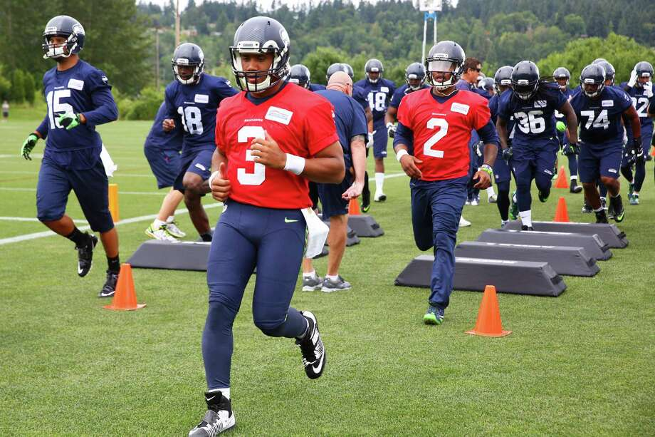 Quarterback Russell Wilson runs through drills during a Seahawks pre-season practice at the Virginia Mason Athletic Center, Thursday, June 9, 2016. Photo: GENNA MARTIN, SEATTLEPI.COM / SEATTLEPI.COM