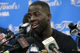 Warriors' Draymond Green answers questions during a media availability session as the Golden State Warriors prepare for game 4 against Cleveland Cavalier of the NBA Championship at Quicken Loans Arena in Cleveland, Ohio on Thurs. June 9, 2016.