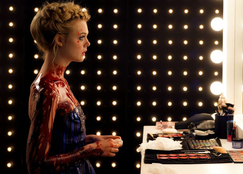 "Elle Fanning (left) is protagonist Jesse in director Nicholas Winding Refn's (right) ""The Neon Demon."" Refn calls it a ""teen horror movie""; it's set in the naturally horrifying L.A. fashion world. Movie opens June 25. Photo courtesy Broad Green Pictures. Photo: Broad Green Pictures"