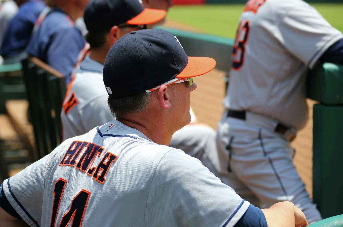 ARLINGTON, TX - JUNE 09: A.J. Hinch #14 manager of the Houston Astros looks on from the dugout in the first inning against the Texas Rangers at Globe Life Park in Arlington on June 9, 2016 in Arlington, Texas.
