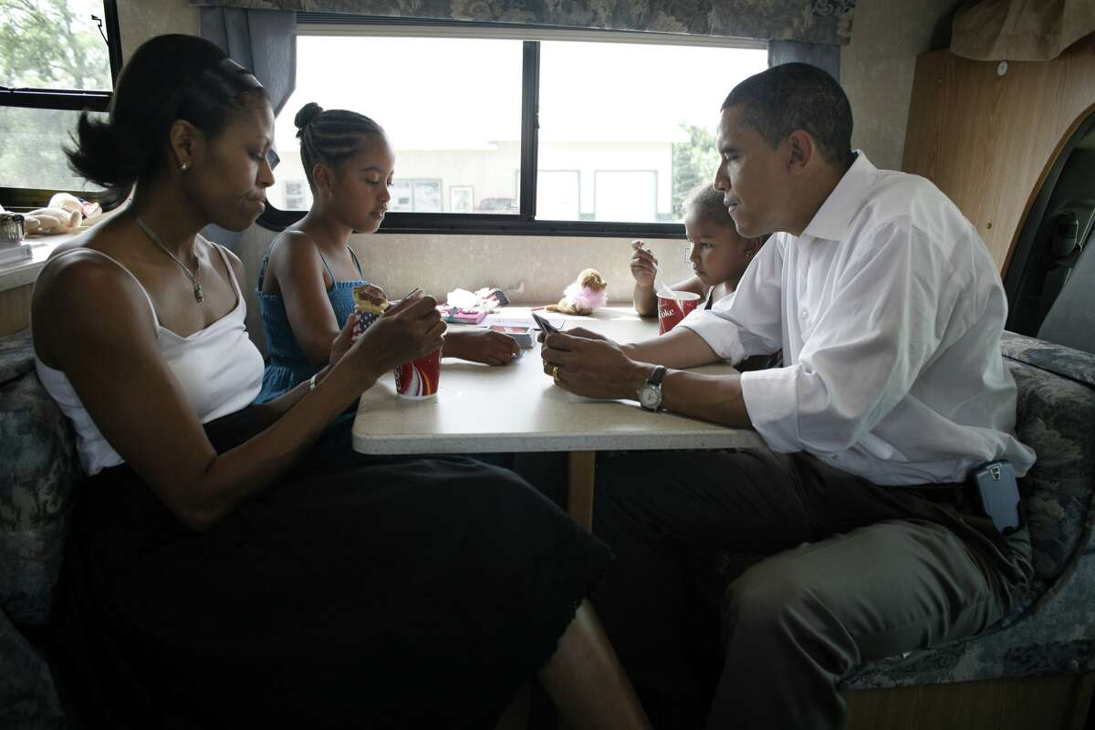 Democratic presidential hopeful U.S. Senator Barack Obama (D-IL), his wife Michelle and two daughters Sasha (6) and Malia (9) play cards in their RV, July 4, 2007 on a campaign swing between Oskaloosa and Pella, Iowa.