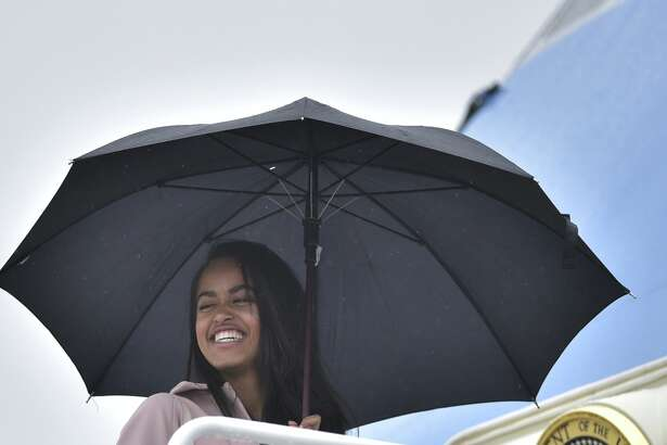 US President Barack Obama's daughter Malia make her way to board Air Force One before departing from Andrews Air Force Base in Maryland on April 7, 2016. US President Barack Obama is headed to Chicago, Illinois for a discussion on the Supreme Court and the country's judicial system.