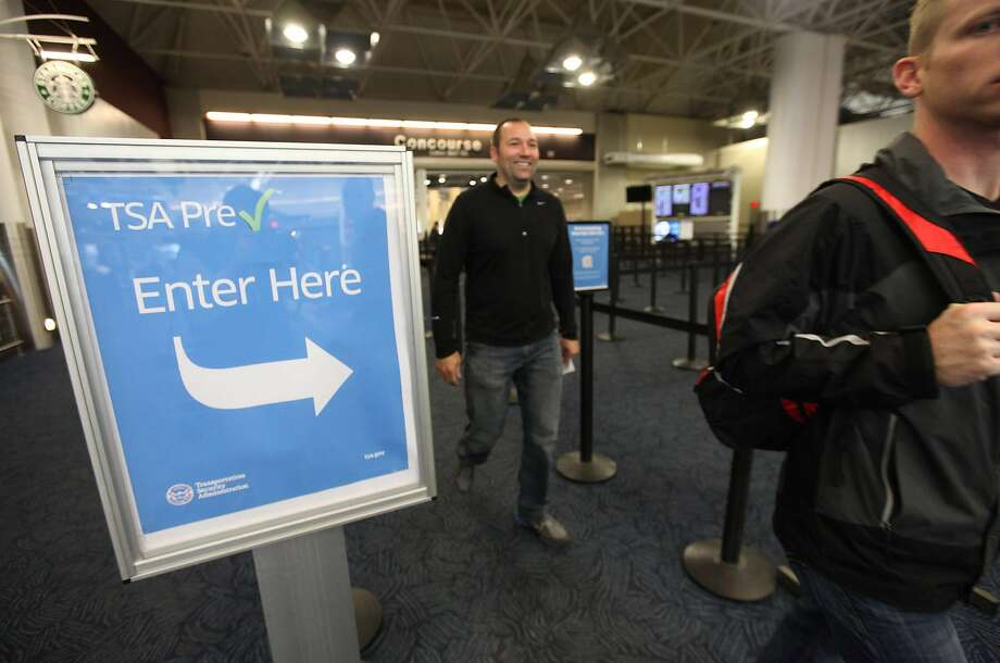 FILE PHOTO: This Oct. 22, 2013, file photo shows passengers walking through the pre-check lane at Milwaukee's Mitchell International Airport.  Photo: Mike De Sisti, Associated Press