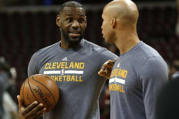 CORRECTS SERIES TO 2 GAMES TO 1 - Cleveland Cavaliers forward LeBron James, left, talks with Richard Jefferson during NBA basketball practice in Cleveland, Thursday, June 9, 2016. The Cavaliers, trailing 2 games to 1, host the Golden State Warriors in Game 4 of the NBA  Finals on Friday. (AP Photo/Paul Sancya)