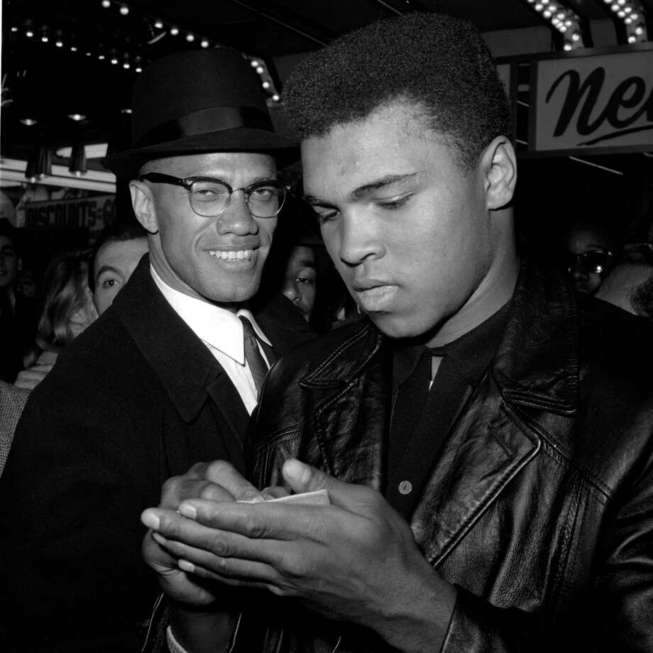 In 1964, world heavyweight boxing champion Muhammad Ali (right) Black Muslim leader Malcolm X leave a New York theater. Ali managed to combine both pride and humility, and both explosive physical violence and pacifism. He was a civil rights contradiction. Photo: Associated Press File Photo / 1964 AP