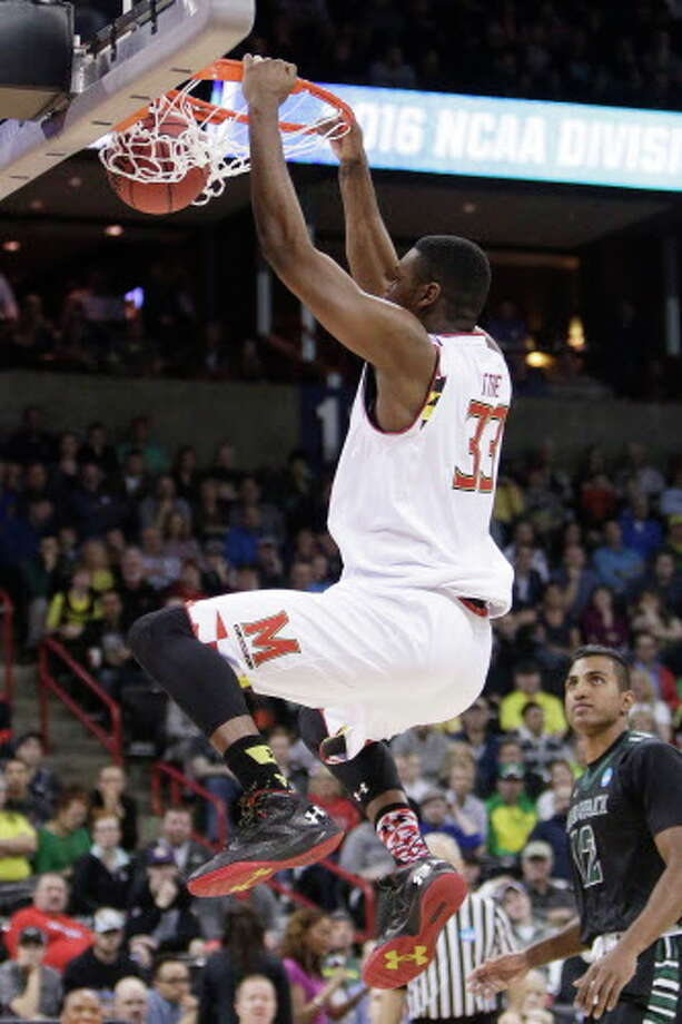 Maryland center Diamond Stone (33) dunks during the first half of a second-round men's college basketball game against Hawaii in the NCAA Tournament in Spokane, Wash., Sunday, March 20, 2016. (AP Photo/Young Kwak) Photo: Young Kwak/AP