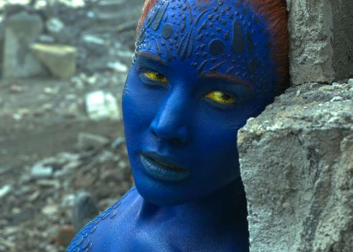 """blue Mystique (Jennifer Lawrence) is in trouble in """"X-Men: Apocalypse."""" A billboard depicting the character being strangled by villain Apocalypse has caused controversy. Photo courtesy Twentieth Century Fox Film Corporation."""