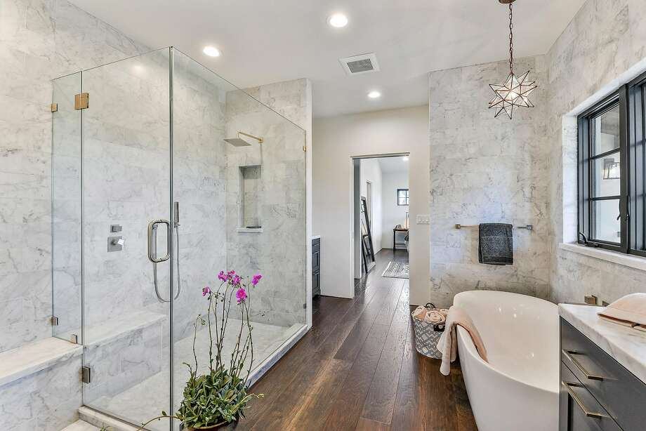 Contractor Duane Heil of August Co. constructed 57 Yorkshire at the end of a cul-de-sac. The master bathroom includes a soaking tub and a frameless shower. Photo: Open Homes Photography