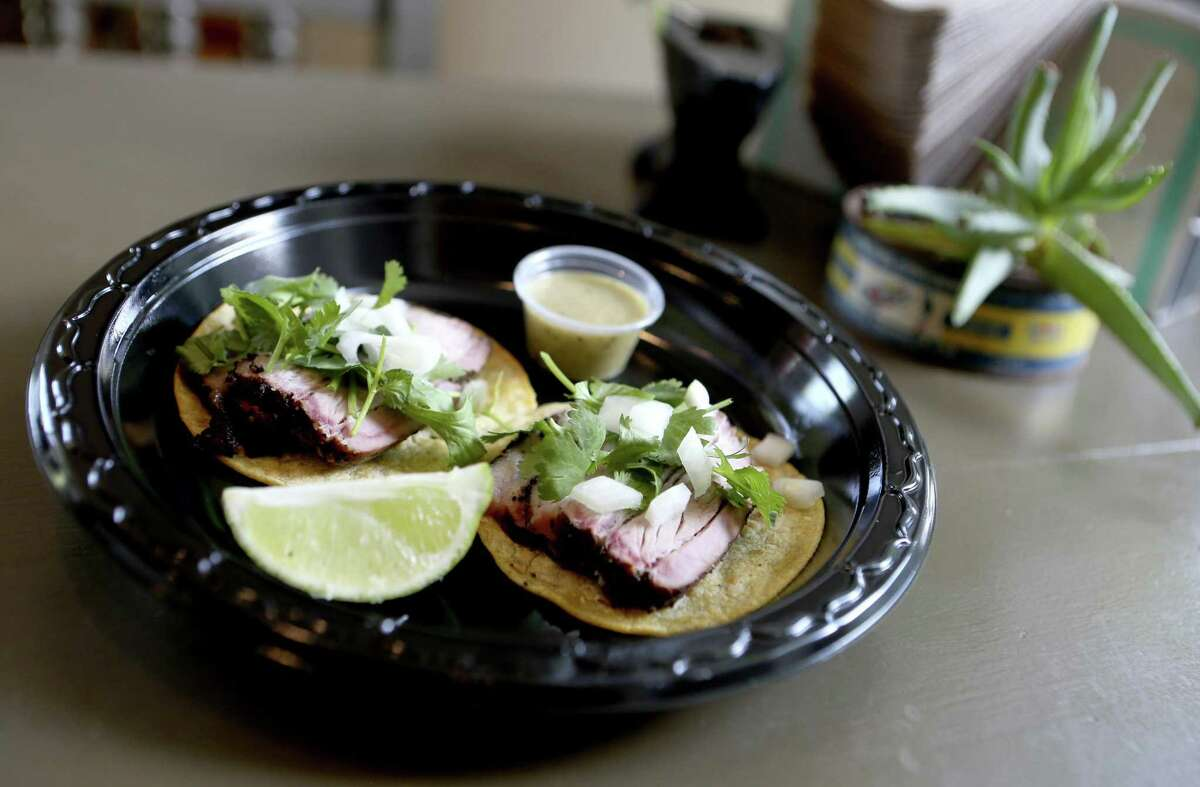 The pork belly street tacos are on the menu at King's Hwy Brew & Cue.