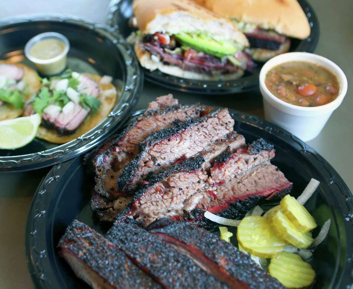 Now this is feast, San Antonio style: (clockwise, from left) pork belly street tacos, brisket torta, borracho beans and a plate of brisket and ribs.