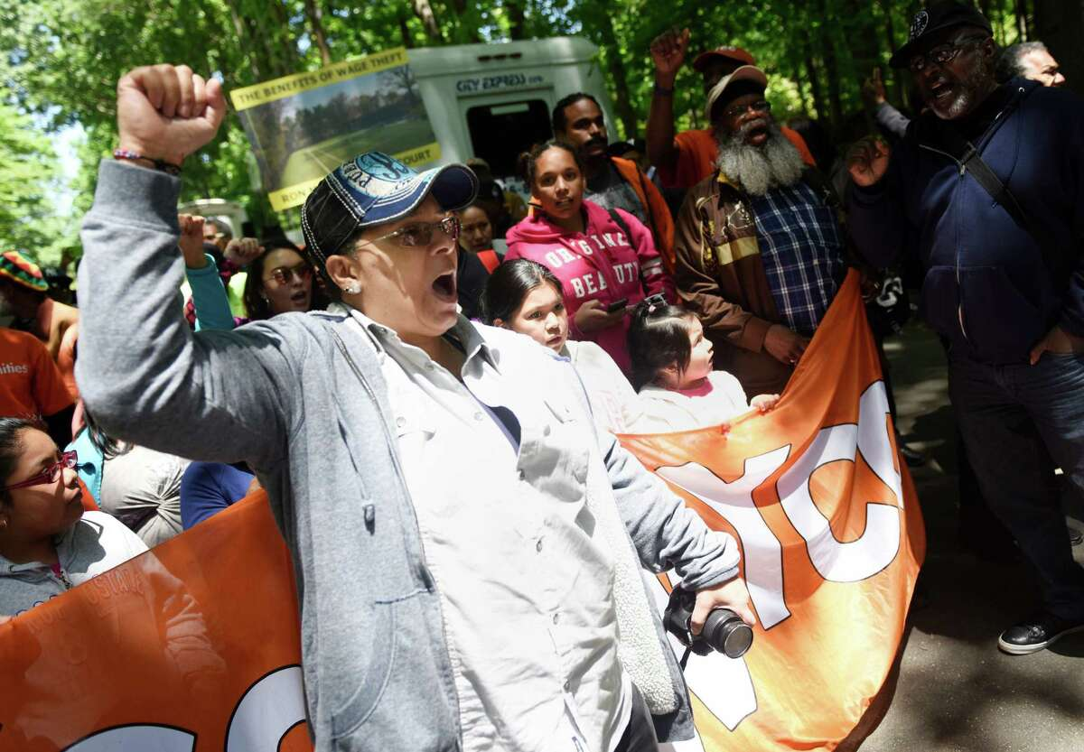 Marie Maisonet, of East New York, Brooklyn, leads a chant with a group of housing activists.