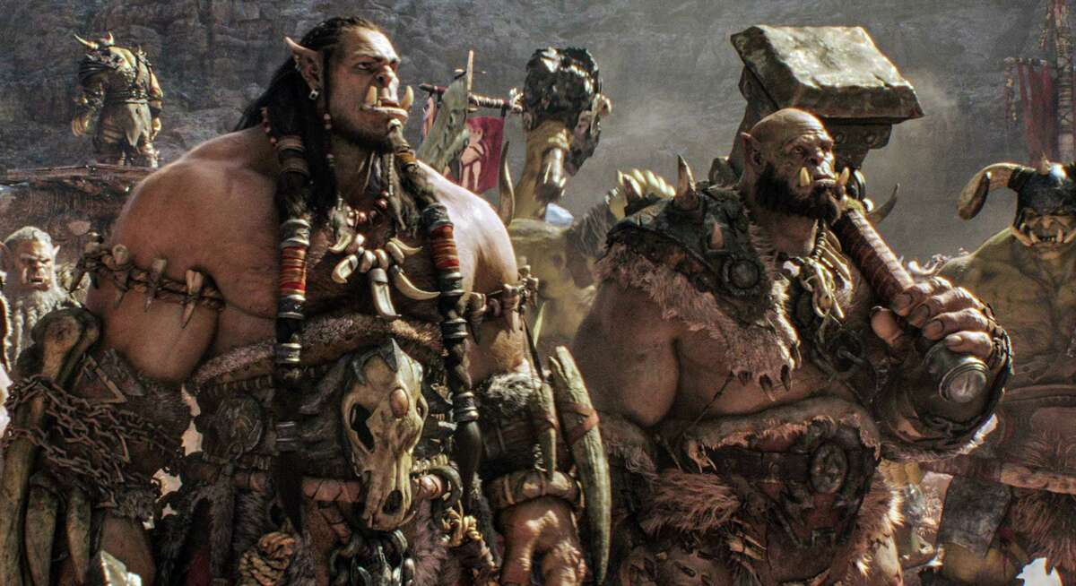 Orc chietain Durotan, voiced by Tobby Kebbell, left, and Orgrim, voiced by Rob Kazinsky, are featured in a scene in