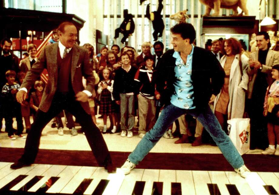 """In this handout photo provided by Please Touch Museum, Robert Loggia, left and Tom Hanks star in the 1988 comedy """"Big.""""   The 16-foot walk-on piano Tom Hanks played in his 1988 film """"Big"""" will be on display next month at the Philadelphia  Please Touch Museum. The instrument is a gift to the children's museum from a couple in suburban Merion who bought it after the movie's release.  (AP Photo/Touch Museum, 20th Century Fox)   NO SALES    PIANO SCENE FROM BIG Photo: HO / 20th Century Fox via Please Touc"""