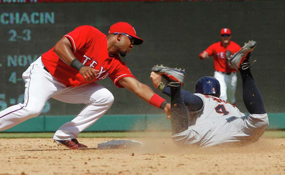 Texas Rangers shortstop Elvis Andrus (1) makes the out on Houston Astros' George Springer (4) as part of a double-play to end the baseball game, Thursday, June 9, 2016, in Arlington, Texas. Texas won 5-3. (AP Photo/Tim Sharp) Photo: Tim Sharp, Associated Press / FR62992 AP