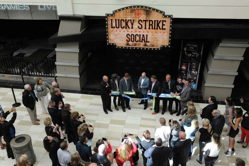 Owner Steven Foster cuts the ribbon as Lucky Strike Social opens for a VIP party on Thursday night and to the general public Friday on Thursday June 9, 2016 in Guilderland, N.Y. (Michael P. Farrell/Times Union)