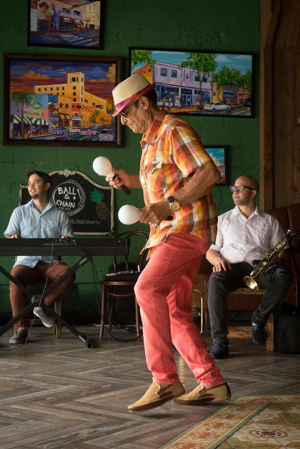 Orestes Sosa, dances as he plays the maracas with a trio performing mostly Cuban songs in one of Little Havana's hottest spots Ball and Chain. Photo: Angel Valentin, Special To The Chronicle