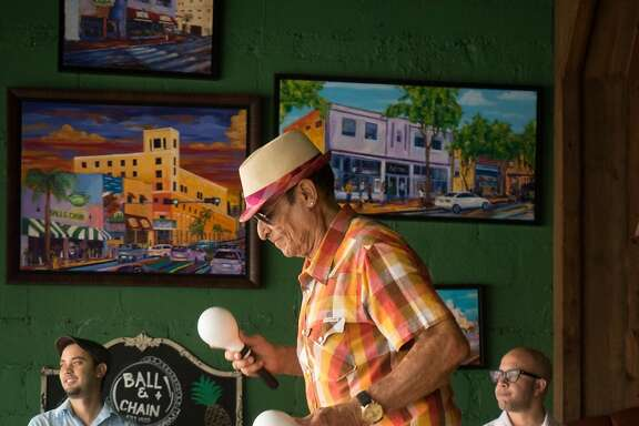 JUNE 9, 2016---MIAMI, FLORIDA Orestes Sosa, dances as he plays the maracas with a trio performing mostly Cuban songs in one of Little Havana's hottest spots Ball and Chain. (Photo by Angel Valentin/Freelance)