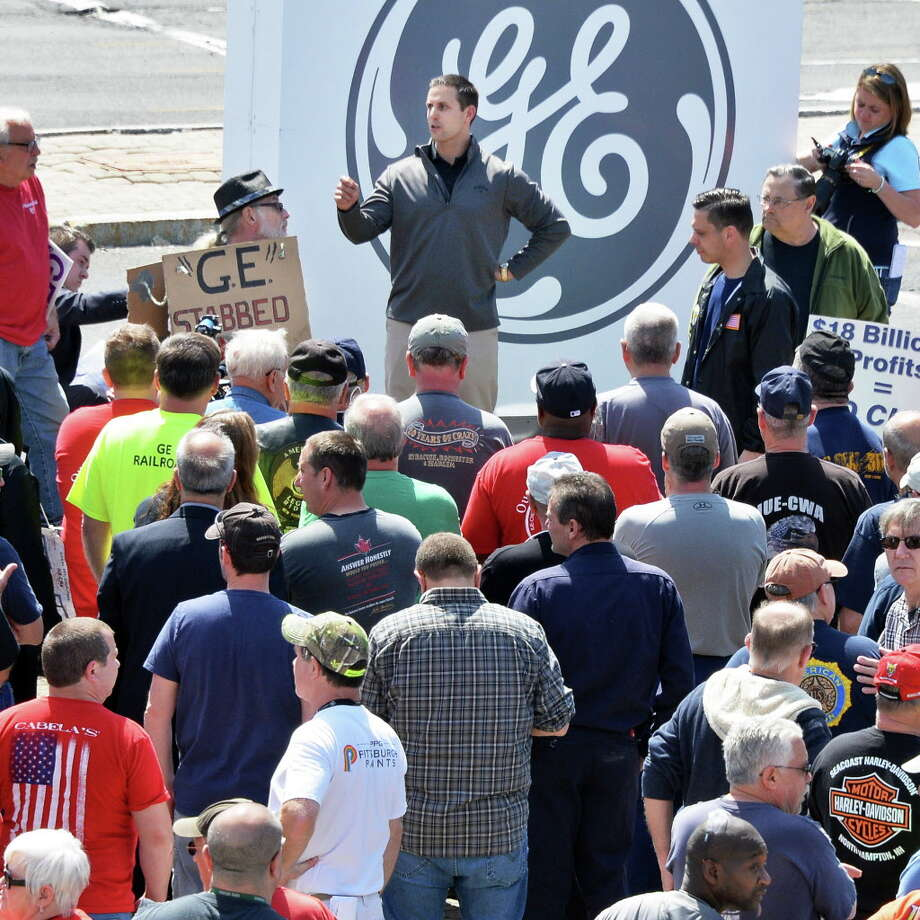 IUE business agent RobMacherone, top center, addresses former and current GE employees holding a demonstration at GE's main gate Thursday April 21, 2016 in Schenectady, NY.  (John Carl D'Annibale / Times Union) Photo: John Carl D'Annibale / 10036288A