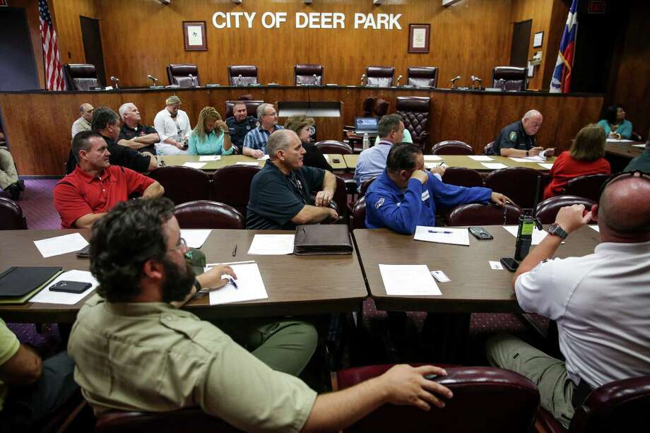 Members of the Deer Park Local Emergency Planning Committee listen to a presentation about hurricane threats by Dan Reilly from the National Weather Service at their monthly meeting at Deer Park City Hall Tuesday, May 24, 2016. Attendees include representitives from chemical plants in the area, city personnel and first responders. Photo: Michael Ciaglo, Houston Chronicle / © 2016  Houston Chronicle