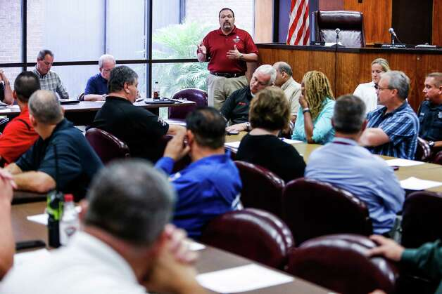 City of Deer Park Emergency Services Director Robert Hemminger makes an announcement about chemical releases at the monthly meeting of the Deer Park Local Emergency Planning Committee at Deer Park City Hall Tuesday, May 24, 2016. Photo: Michael Ciaglo, Houston Chronicle / © 2016  Houston Chronicle