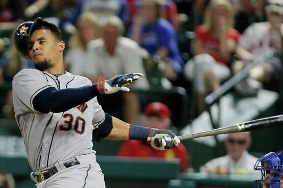 Houston Astros Carlos Gomez's (30) helmet falls off after swinging at a pitch in the ninth inning of a baseball game against the Texas Rangers, Tuesday, June 7, 2016, in Arlington, Texas. Texas won 4-3. (AP Photo/Brandon Wade)
