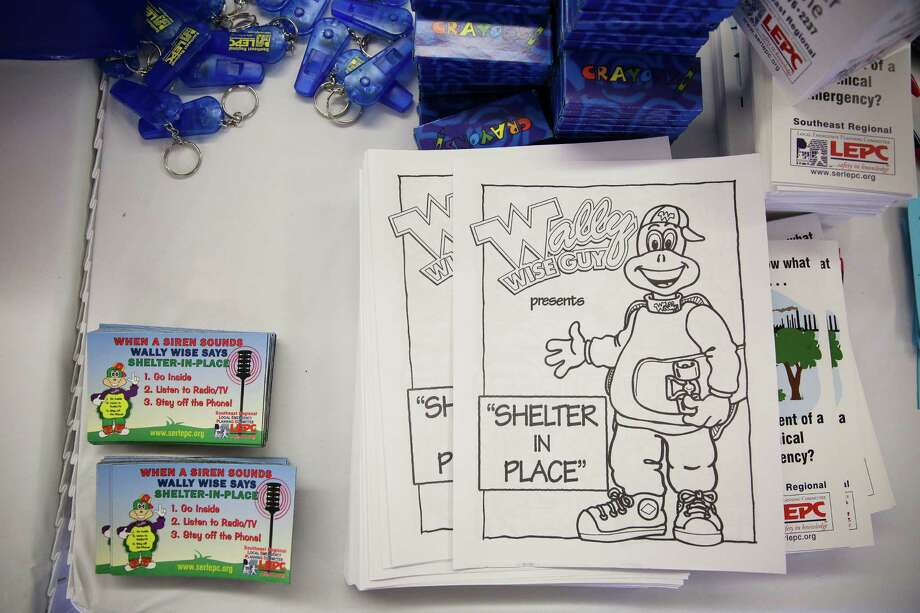 Coloring books and magnets for Wally the Wise Guy turtle, who helps teach kids how to shelter in place, sit on a table outside the Pasadena Convention Center during the hurricane workshop Saturday, June 4, 2016 in Pasadena. Photo: Michael Ciaglo, Houston Chronicle / © 2016  Houston Chronicle