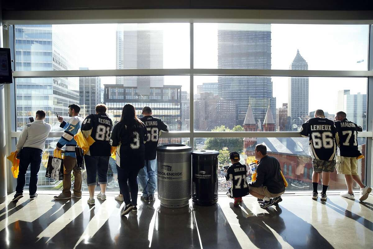 Pittsburgh Penguins' fans photograph the throng outside Consul Energy Center before San Jose Sharks play the Penguins in Game 5 of the Stanley Cup Final at in Pittsburgh, PA, on Thursday, June 9, 2016.