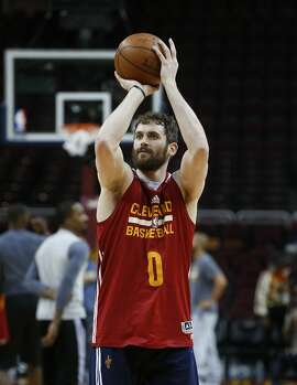 Cleveland Cavaliers forward Kevin Love shoots during practice for Game 4 of basketball's NBA Finals in Cleveland, Thursday, June 9, 2016. (AP Photo/Paul Sancya)