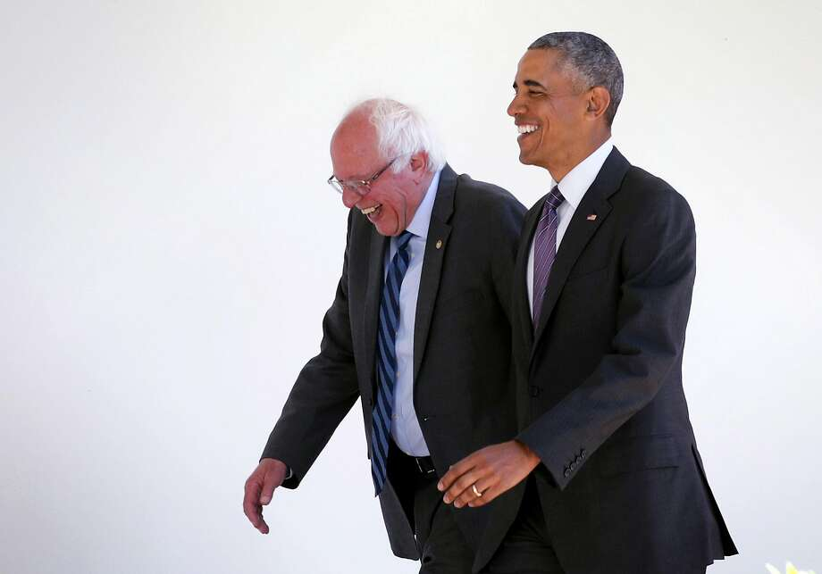 Democratic presidential candidate Sen. Bernie Sanders (left) of Vermont, arrivings Thursday for an Oval Office meeting, walks through the White House colonnade with President Obama. Photo: Alex Wong