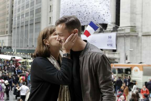Square CEO Jack Dorsey gets a birthday kiss from his mother, Marcia Dorsey, before his company's IPO at the New York Stock Exchange, Thursday, Nov. 19, 2015. Square, the 6-year-old startup known for its white, cube-shaped card readers that plug into smartphones, is surging in its first day as a publicly traded company. (AP Photo/Richard Drew)