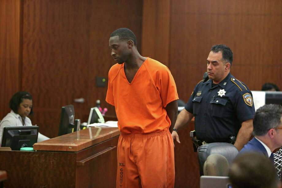 Darrell P. Mitchell, 28, appears in court Thursday at the Harris County Courthouse. His murder charge was upgraded to capital murder after a second victim died. Photo: Gary Coronado, Staff / © 2015 Houston Chronicle